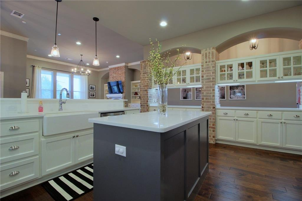 Stunning Custom!..This gorgeous home boasts 12 Ft. Ceilings and wood floors that are carried throughout the entry and into the spacious living room with built in shelves, a cozy fireplace,upgraded lighting and soaring windows .Floor plan layout is A true 4 bed /3.5 bath with a study and bonus/game room.Two of bedrooms are Jack-n-Jill and the other room is private with its own bathroom.Checkout this DREAM Kitchen ... gas stove,white quartz counters, soft close drawers, pantry, Fridge can stay(with acceptable offer) ,island with wine fridge large credenza and breakfast bar making entertainment a breeze. Beautiful, large master with a large on-suite you wont want to leave upgraded tile, stand alone tub, glass shower and walk in closet.The bonus room features built in shelving.Enjoy sunrise(East facing) on your back covered patio.(patio has speaker and TV hook-ups) The HOA includes Pool(for the reserve only), 4 parks, Ponds, and several parties throughout the year. Storm shelter in garage.