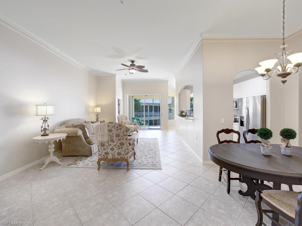 RARE LAKEFRONT 2ND FLOOR END-UNIT WITH ATTACHED GARAGE IN NORTH NAPLES' COVETED STERLING OAKS! Boasts a stunning lake & fountain view with prime Southern exposure for breathtaking sunsets & natural light throughout. This spacious unit with HIGH CEILINGS & OPEN 3 bedroom + den floor plan is one of the largest condos in the community! Rare end-unit location offers extra privacy & sunlight! This home has been lovingly & immaculately maintained from the NEW 2021 TILE ROOF, impact glass windows, shutters & premium marbled tile to the new paint, crown molding, plantation shutters & white cabinetry kitchen with new stainless-steel appliances. Resort-style amenities include BRAND NEW state-of-the-art clubhouse with restaurant, fitness center & pro shop, 135K gallon pool with Cabana Bar & Grille for a vacation lifestyle year-round, 2 Pickleball courts, 2 bocce courts & optional tennis program with 12 Har-Tru lighted courts. Sterling Oaks is gated & ideally located West of US-41 in North Naples/Collier County, less than 4 miles to Bonita Beach, Barefoot Beach & Vanderbilt Beach. Dining & entertainment abounds with Mercato & Waterside Shops nearby. Easy access to RSW Intl Airport. A must-see!
