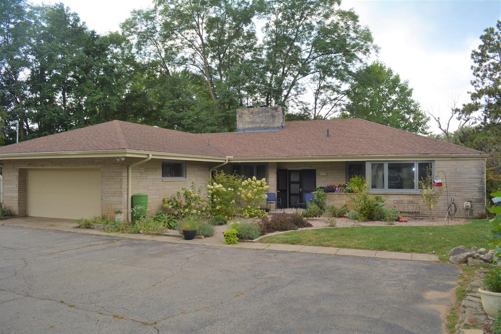 Located in beautiful Summit Twp, Jackson County, this Mid Century remodeled ranch home on the Grand River awaits you. Main floor features beyond the welcoming foyer include a new contemporary floor plan with living room with fireplace, dining area, kitchen with full appliance package, private balcony, dry bar/wine area, master suite with on suite bath and walk-in closet, additional bedroom, additional full bathroom, laundry room, and storage. Lower level finished walkout basement features a family room with pool table, a bedroom, two full bathrooms, room for another bedroom or office, three season room and multiple doors to the patio and river frontage. Perched along the Grand River, take your kayak or canoe to Williams Lake, Browns Lake, and beyond. An amazing opportunity awaits you!
