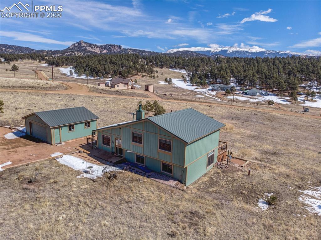 This home is True pride of ownership, shows perfectly.  Very well maintained and manicured home on over 5 acres of all usable property.  Horses or other livestock permitted. Views of Pikes Peak, Sheep Nose Rock and Dog Head. Easy level access with 2 car garage even with main level. Living room boasts vaulted ceilings and free standing wood burning stove. Dining room offers walk out to wrap around composite decking to enjoy our beautiful Colorado outdoor living. Kitchen has breakfast bar, Craftmade Oak cabinets, Built-in