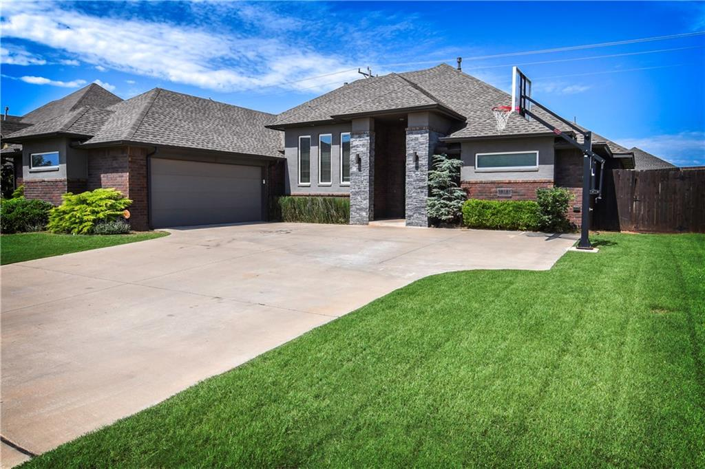 MUST see this beautiful custom built Jeff Click home! This home is one of a few modern homes in the area and won't last long! Great floor plan for entertaining, and also very functional! This home offers brand new updated wood look tile in main areas, a privacy fence and nice sitting area outside with gas firepit. The master suite is very large and features a walk in shower and two separate vanities! The master suite is separated from the other 2 bedrooms. This home also offers a theatre room, an office or separate dining room, reading, or anything room, as well as 3 bedrooms, and 2.5 bathrooms! The 2 car garage is oversized and opens up to the mudroom and laundry room! The master closet is HUGE and there is plenty of room for clothing, shoes and more! There is a GREAT neighborhood pool and park just ONE block away, and this home is VERY close to restaurants, Quail springs mall, movie theatres and more! You don't want to miss out on this rarity in the Edmond/OKC area!