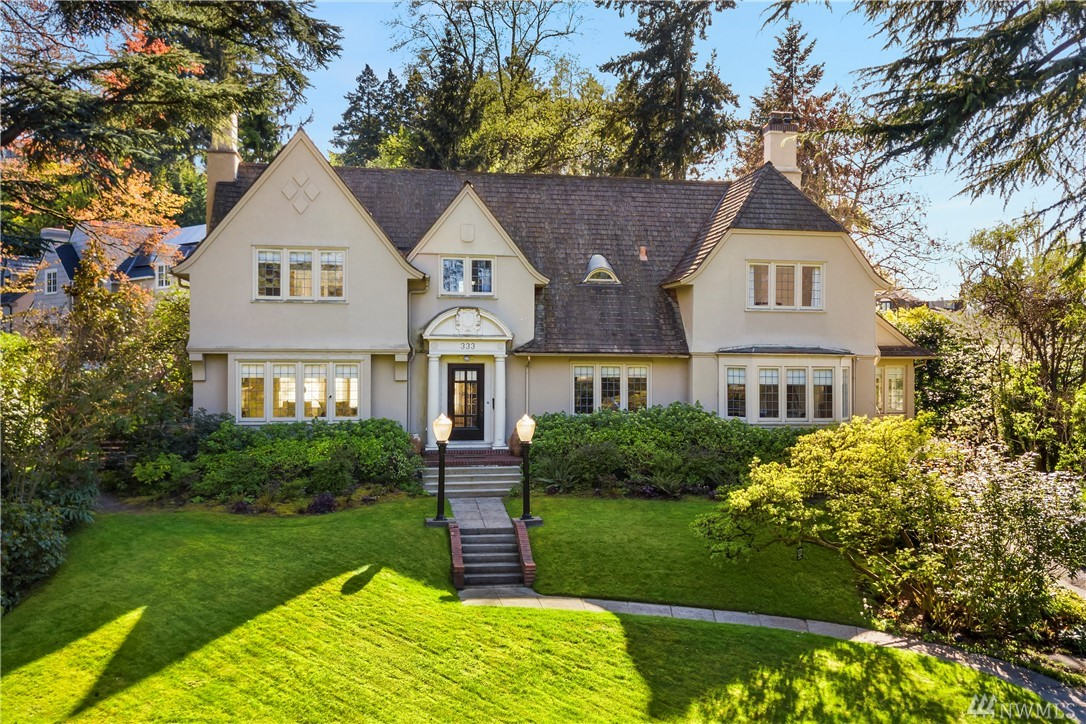 Perched on a wonderfully landscaped & private 27,635 sqft lot, this elegant storybook home features grand spaces & elegant modern finishes. Refined formal rooms are bathed in sunlight that filters in through leaded glass windows & the gleaming hardwoods & period detailing combine with a sophisticated level of finish to create the perfect combination of old & new worlds. The grounds features a charming, artist's studio with loft & lovely 1360 sqft 1 bd/1bth apartment over a 2 car carriage house.