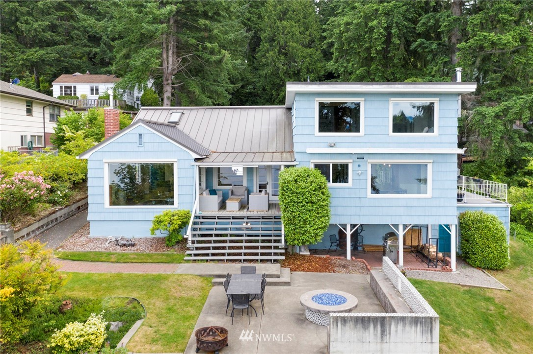 Nestled on .74 acre lot with 104 feet of Bremerton's finest waterfront. Located on Phinney Bay, boasting of breathtaking views of the Bay and Olympic Mountains. Enjoy entertaining from the gourmet kitchen with stone countertops, full height tile backsplash and SS appliances. Original charm still beams throughout this beautiful home with original hardwood flooring & windows. A luxurious place to call home and become a master of outdoor recreation with boating, sailing, paddle boarding, kayaking, including endless fun on the swim platform that is secured by two helical anchors, capable of holding a boat up to 75 feet, all from your back yard. Seattle, just on the other side of the Puget Sound, can be reached via the Bremerton/Seattle ferry.