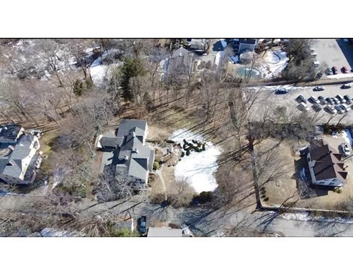 """Comfortably settled in Dedham Square with walkability to the village shops and restaurants, parks and public transportation. Live in the company of history in a tastefully designed home with all the modern conveniences. This largely clear, 21,523 square foot lot offers the perfect spot to build your dream home. See """"76 Old River Place"""" MLS #72795673 for a house lot package offered with custom builder, Oracle Homes to see how you can turn this ideal location into home."""