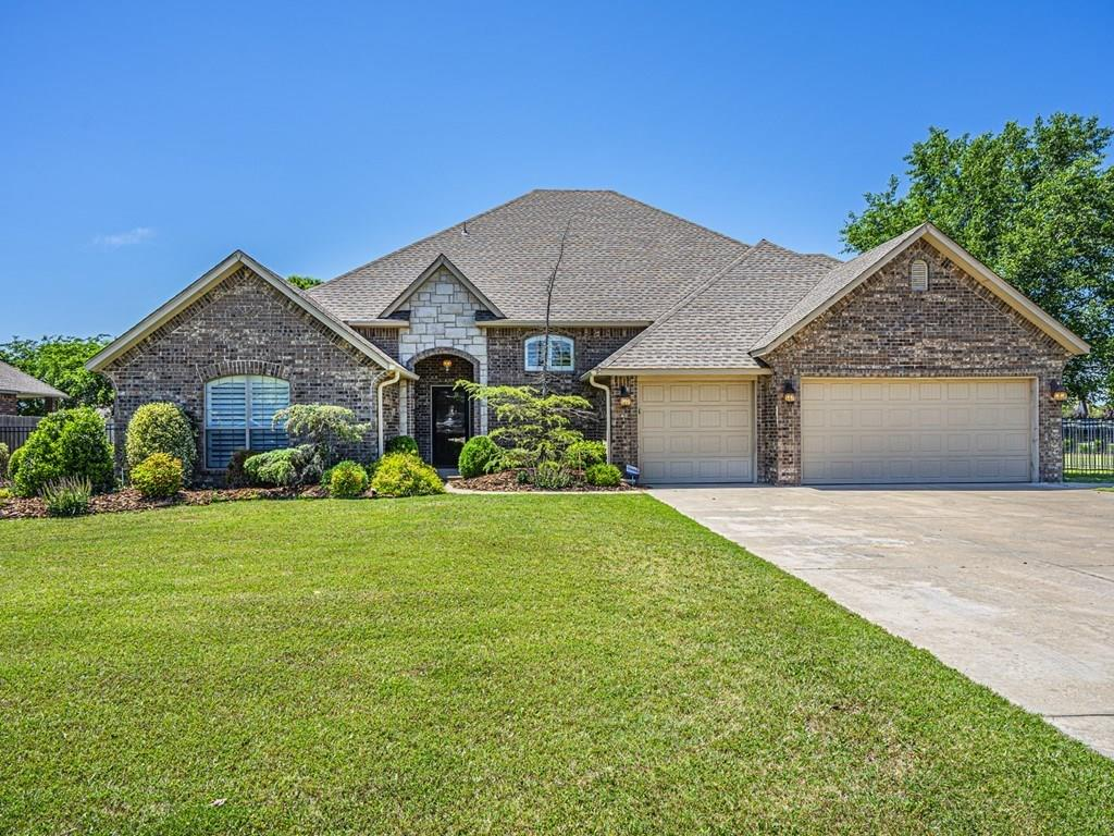 Hard to find 6 bedroom home in the highly desirable Highland Trails neighborhood. The lovely home includes plantation shutters on the main floor, raised wood flooring in the formal dining, granite counters with tile back-splash in the kitchen and craft room, and a wood burning fireplace in the living room. You find the Master bedroom and a guest bedroom downstairs and 4 bedrooms upstairs!  The flexibility of this floor plan offers many options, such as a bedroom/study, or a bedroom/game room, or maybe a bedroom/exercise room.  The back patio offers a wonderful outdoor living experience with a covered patio, a pergola covering an outdoor kitchen area with grill, side burners, mini refrigerator, and granite counters including a bar area. The gas fire pit makes a great place to relax and enjoy the sunsets while looking over the big backyard! There's even a big in-ground storm shelter with a stamped concrete finish near the patio. Check out the virtual tour and don't let this one get away!