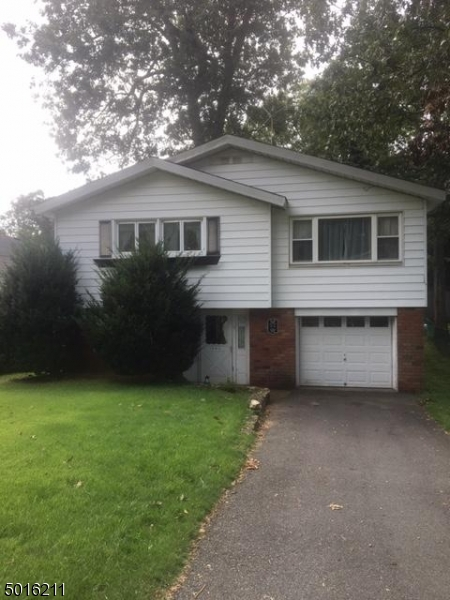 Back-to-front raised ranch on a level lot with tranquil views of nature. 4 bedrooms, living room, kitchen, family room plus home office. Garage & patio. Needs TLC. New water softener to be installed. SOLD AS IS.  $30,000 credit for TLC with full price offer. HDW floor under carpets