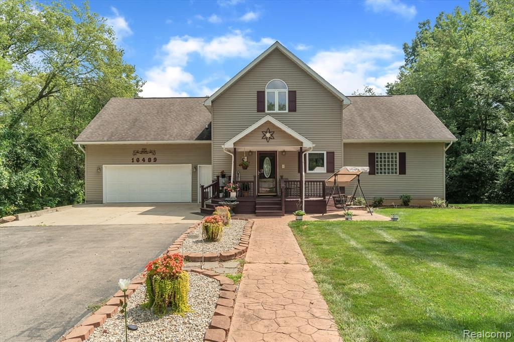 Come Home to an Up-North feeling!!! Enjoy Fishing, Swimming, Wildlife, and Beautiful Views Everyday. Over 4,000 sf. of living space on 2.23 acres. The Great Room is flooded with natural light and is open to the kitchen. First floor Master Suite has huge walk-in closet, private entry to deck and an amazing Master Bath. Downstairs is 2 bedroom in-law suite, which has it's own views of the lake. The Kitchen has a walk-in pantry and entry to private patio area. Both bedrooms have private access to bathroom. Upstairs you will find a Theater Room, presently being used as a Workout Area. There is also 2 bedrooms, and full bath. All 3 floors have views of the lake. 48x37 Pole barn with tons of parking. The mechanicals are impressive in this home 240 amps in Garage,  2 furnaces one of them is new, whole house vacuum system, intercom system, and invisible fence. Lobdell Lake is accessible from Little Darling. New Cabinet Fronts throughout home.