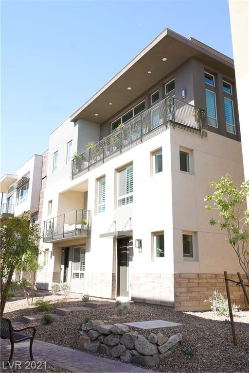 Highly desirable Summit model!! Check out both Virtual Tours!! All living space is on the third floor, first floor is foyer, garage and Private elevator only, opens into your stunning new living space, it's like your own private high rise...Stunning Strip Views from the front and private mountain views from the back balcony and windows! Open floor plan, high ceilings, too many upgrades to mention them all but custom shutters, custom cabinets is a good start, high ceilings, located in the coveted corner of the best 55+ complex in the city!