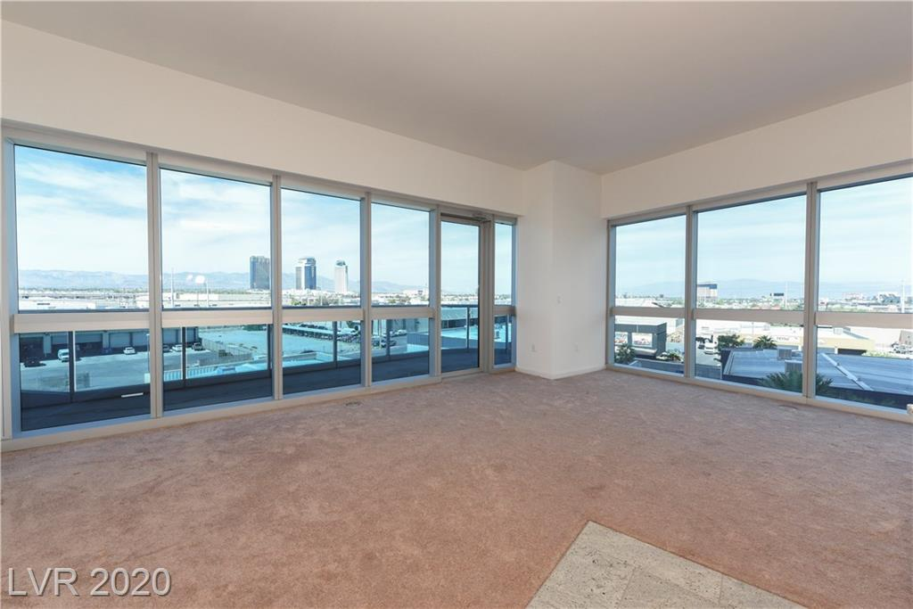 Gorgeous 1 BR/1 BA, huge balcony with Strip & Mountain Views. Walls of glass, open and spacious floorplan, and updated kitchen.
