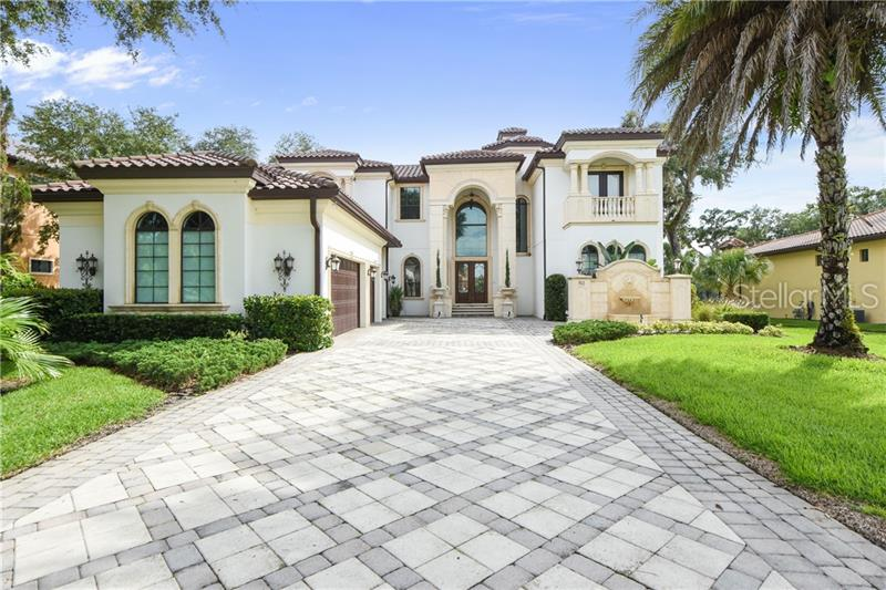 LUXURIOUS RIVERFRONT LIVING awaits in this ENTERTAINER'S ESTATE PARADISE with PRIVATE ACCESS to the ST. JOHNS RIVER! Breathtaking WATER & ISLAND NATURE PRESERVE VIEWS, a PRIVATE DEEP-WATER BOAT DOCK w/ LIFT, sunset cruises, skiing, paddle-boarding, fishing & more are just a few steps away. This Mediterranean-inspired home offers an OPEN SPLIT-LEVEL FLOOR PLAN with nearly every room opening to PANORAMIC WATER VIEWS. Upon entering, your senses are overloaded with an abundance of natural light, SOARING 24' CEILINGS, a majestic GAS FIREPLACE, a WINE BAR, plus a direct path to the PRIVATE POOL & rear backyard. Enjoy the SWEEPING VIEWS from the CHEF'S DREAM KITCHEN boasting top of the line STAINLESS STEEL APPLIANCES, GRANITE COUNTERTOPS, CENTER ISLAND, and striking COPPER CEILINGS. The kitchen opens warmly to the impressive family room, views still commanding attention. Wake up every day in your first-floor master retreat with serene views and luxuriate in your spa-like master bath. This IMPRESSIVE HOME also offers a CUSTOM HOME THEATER ROOM. Continuing quality spills from the inside out as you relax & enjoy the breathtaking sunsets lounging by the private sparkling pool with a tiled fountain & 8' long fire feature. Don't forget to bring your boat! Let the river be your highway as you enjoy a relaxing boat ride to dinner, first class fishing or incredible boating navigable for 120+ miles to Jacksonville & to the Atlantic Ocean. Zoned for TOP RATED SCHOOLS. Enjoy your own personal oasis in this spectacular home!