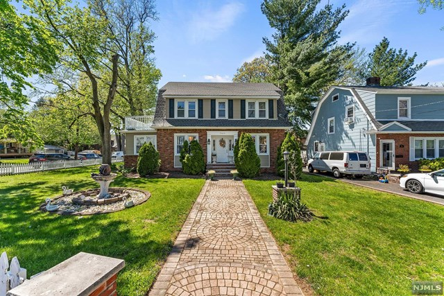 Extraordinary Bergenfield Center Hall Colonial, the perfect marriage of character & charm w/today's modern luxuries. Immensely appealing; each RM provides space, ambiance & tranquility simultaneously. Warm, cozy & bright, 4-BDRM, 3-BTH gem! Gracious foyer, formal DR, spacious LR and bonus 1st level flex RM, full bath and HWFLRS throughout. Enjoy cooking? Eat-in kitchen with loads of granite counters & center island. 2nd level 4 ample sized BRMS & gorgeous renovated FB with marble finish. 3rd level BR and sitting area.  Separate entry finished basement with full bath, flex room, laundry and storage. Spend your nights in your private yard with patio or on your oversized roof deck enjoying a cocktail or two. Near great schools, park, village shopping & NYC trans. You'll fall in love!