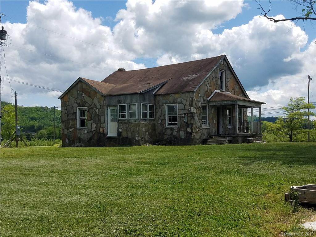 Rock home with a lot of potential.  House has already been gutted and ready for someone to come in and finish the work.  Estimate to repair home quoted at $80k, estimated value once repaired $250,000+.  Flat lot with views of the mountains.  Please do not enter house due to condition of floor joists.  House is being sold as-is.  Please note house has no heating system. Possible HLA is approximately 1104.  Septic was for 3 bedrooms.  Located just off Chimney rock rd.
