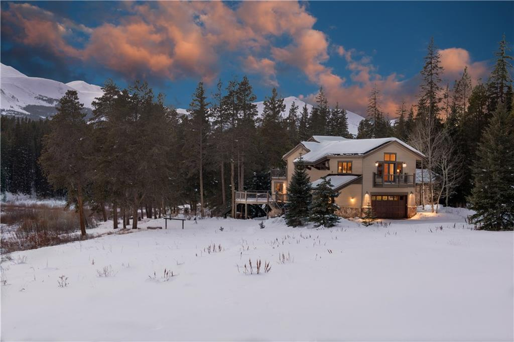 You won't settle for anything but total privacy in the most exclusive community in all of Summit County.  There is both a main home and guest house with 270 degrees views, and 2.23 acres surrounded by almost 50 acres of green belt. There is an adjacent picnic area with a built in kitchen and fire pits by Indiana creek. The community has tennis courts, a boat house, and a lake to fish in.  Also, a stable to keep your horses in all summer with thousands of acres of trails to ride on.