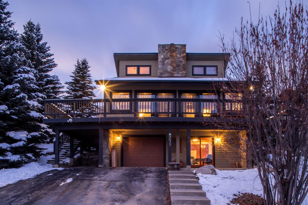This charming, south-facing home maximizes mountain views and sunshine year-round. This home offers expansive views, amazing access to a variety of outdoor activities and close proximity to the Big Sky Town Center. Sliding glass doors in the living area and a wrap around deck offer an incredible indoor/outdoor living experience perfect for entertaining guests. The main level has an open concept living, dining, kitchen area with high ceilings and a  stone feature wood burning fire place. The master bedroom/bath is on the main floor while the upper level has two bedrooms and a full bath. The lower level includes an additional living space with a pellet stove, a bedroom, bathroom and laundry area. With bedrooms and bathrooms on all floors, this home offers privacy for family living or for vacationing with friends and family. New high efficiency windows and doors were installed in 2017. Access to cross country skiing, hiking and biking trails & Big Sky golf course right out your front door