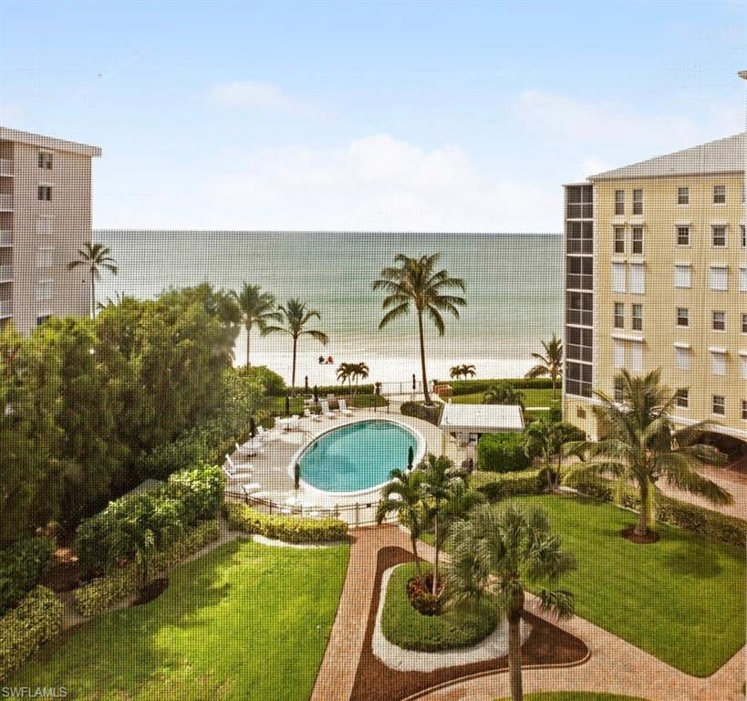 Ready to take a few steps from your door and be on the beach? This breathtaking 2 bedroom/ 2 bath completely renovated oasis will not last! Every window has a view of the gulf or bay. Beautifully done with custom remote window shades and decorated by Robb & Stucky Interiors. 2018 renovation includes: hardwood floors, smooth ceilings, all new plumbing fixtures, light fixtures, crown molding, HVAC, refrigerator, dishwasher, washer/dryer, kitchen cabinets refinished, custom master closet & fresh paint & wallpaper.  A major facility renovation took place in 2017 and the $42,000 assessment has been paid. Coming in 2021, a brand new pool! And that assessment has been fully paid as well!  Come see this slice of paradise for yourself, take in the views, feel the sand and live carefree with everything already updated and assessments paid!