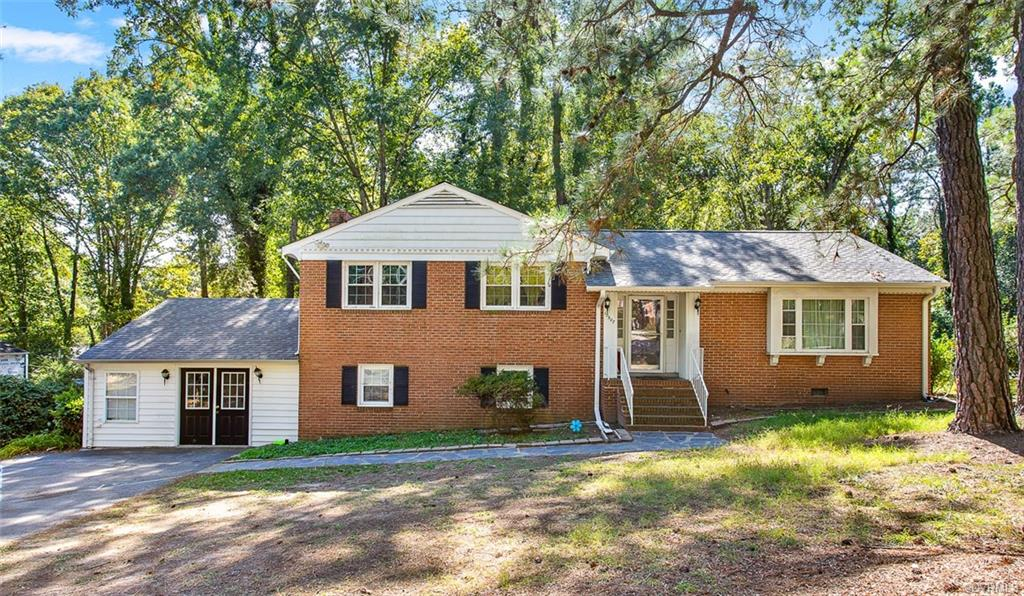 CHARMING 5 BEDROOM 2.5 BATH tri-level home in Henrico County.  Step in from the front porch to find the 1st level foyer area, the FLR with built-in shelves & cabinetry, a picture window & open to the FDR that is attached to the eat-in kitchen w/wood cabinetry, SS wall oven, electric range, dishwasher, tile backsplash, laminate countertops & double sink. The 2nd level houses 2 BDRMs w/closets, the 8X5 hall bath w/tub & shower & the primary BDRM w/ATT 8X3 primary bathroom w/an easy entry tiled shower. The basement level boasts a large partially wood paneled family room w/a wood burning stove & laminate flooring, the 8X7 half bath, a laundry room area & the converted carport area w/BDRM 4 & another area that could be used as a 5th bedroom or home office space. The vast backyard features a partially fenced area, the 16X8 concrete patio & a 14X12 deck that are the perfect spots to entertain family & friends. Located close to shopping, dining & zoned for top Henrico County Public Schools. SCHEDULE YOUR TOUR TODAY!