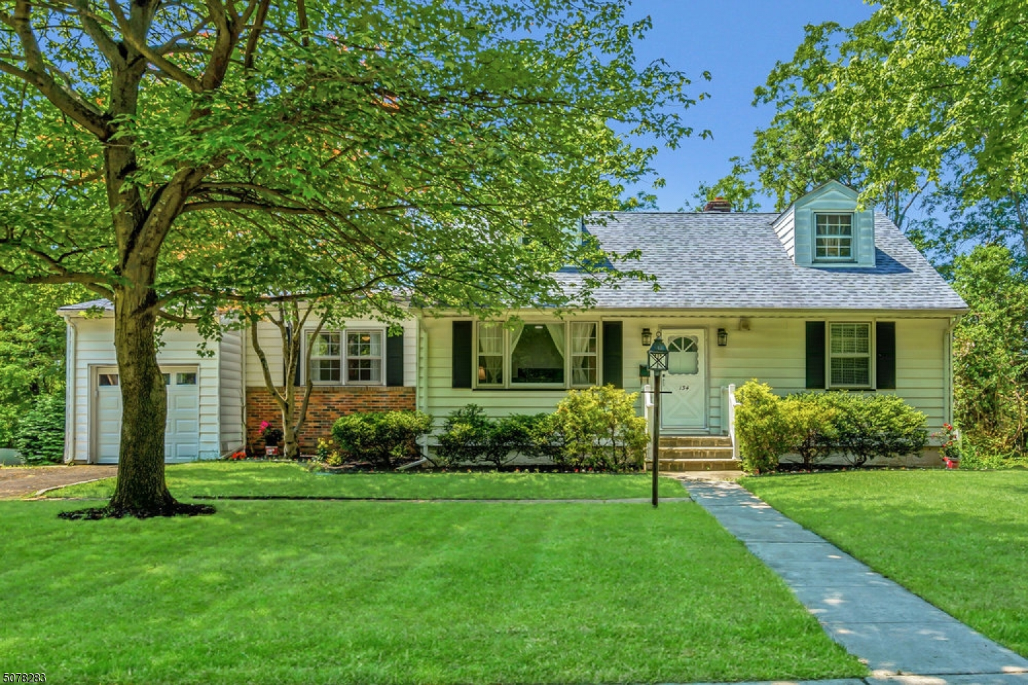 Welcome to this Sun Filled Home! Beautifully refinished w/ room for all. Short distance to NYC Direct Train. Millburn is known for its Top Rated Schools/Quaint Downtown/Shopping/Great Restaurants & Picturesque parks. All new Baths. New Furnace & Central Air. New electric panel-All new smart lighting. New Garage Door/Vinyl fencing/Appliances. So easy to maintain. The first floor offers great flow, w/ Large Living Room& Dining Room, Eat In Kitchen, Two Large Bedrooms, Full Bath & Sweet enclosed Porch leading to Garage & Yard. Upstairs are 2 additional Bedrooms & Another Full Bath. The lower level has a Fantastic Rec Room/Exercise Area/Laundry Area/Workshop and Large Storage/Work-Office space. Walk out to Yard. This home has so much to offer, stop by for a visit soon.