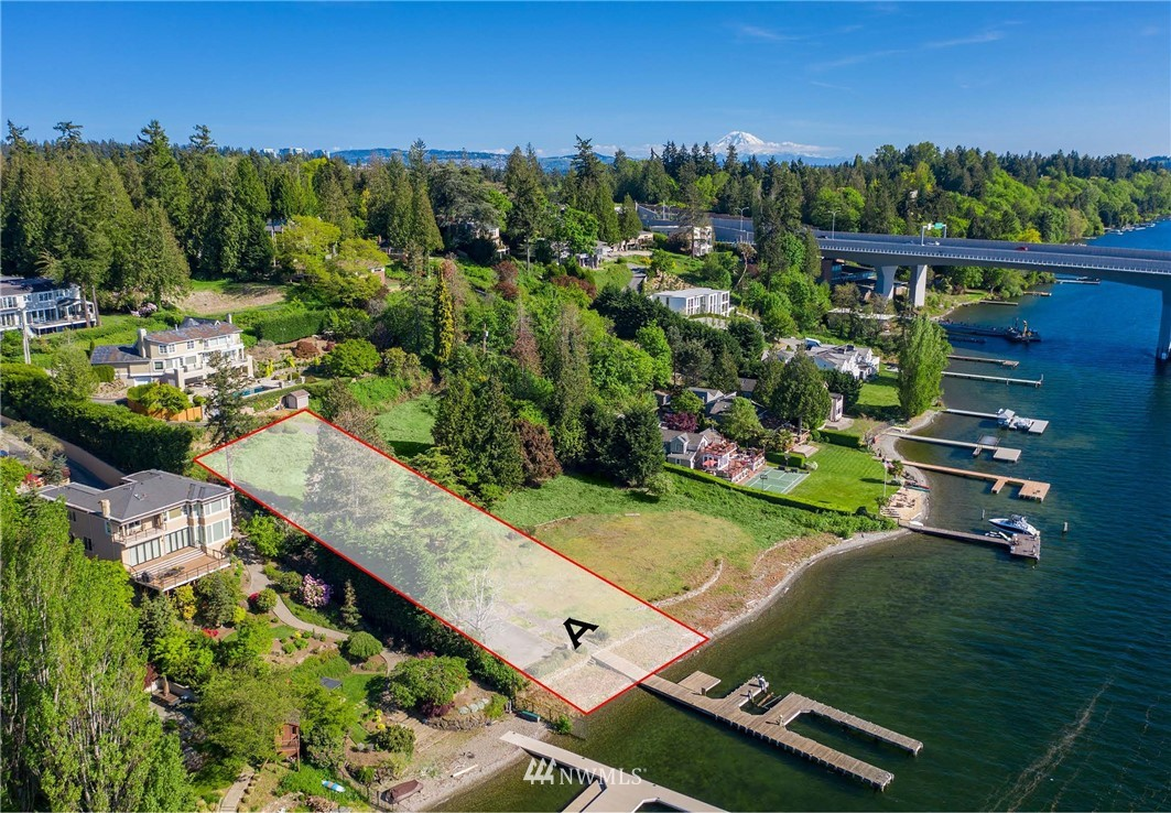 An unmatched development opportunity on pristine waterfront. Lot A is Approximately .68 acre (29,883 sq ft) with 117 feet of waterfront and large private dock.  Lot A could accommodate a 7,000-9,000 sq ft home under current code.  Buyer to verify.  This low bank, west-facing location is pole-position on one of the most coveted stretches on the shores of Lake Washington.  Adjacent Lot B is also available for purchase.