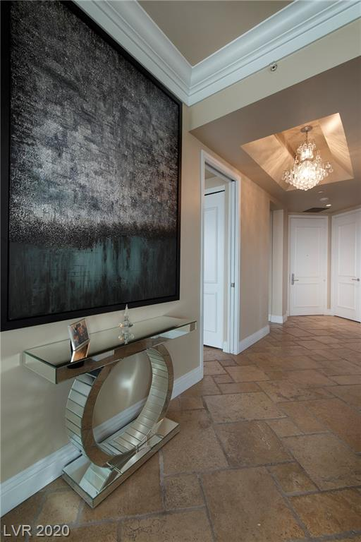 Beautiful Turnberry 2 bedroom high-rise with custom stone flooring through out the unit. Panoramic views form the 35th floor. Granite counter beautiful kitchen with a pantry.  A MUST SEE!!