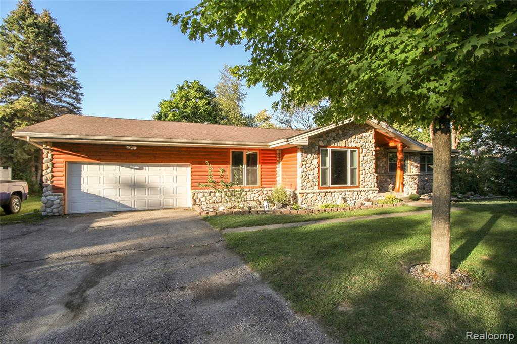 Beautiful custom ranch in Davison schools... You do not want to miss out on the opportunity to view this beautiful home on almost 1 acre with a 24X36 pole barn that has 12' side walls, cement floors and a heater! This home has lots of custom wood work throughout along with beautiful tile and granite in the main bath. Spend your evening in front of the fire place or on the large deck that includes a hot tub. This home has 3 larger bedrooms 1 full bath and 2 1/2 baths, not to mention a home office or game room. Call and schedule your appointment today. Buyers agent to verify all information.