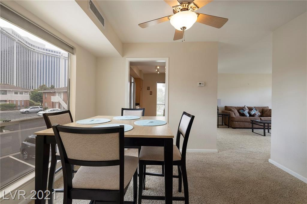 Don't miss this RARE CORNER UNIT, located in the Prestigious, Historic Las Vegas Country Club, nestled in heart of downtown and adjacent to the Las Vegas Strip.  This ready-to-move-in, immaculate 1 Bedroom, 1 Bath open concept unit has a neutral palette that has an abundance of natural light, including windows in the kitchen, living room, and the breakfast nook/dining area. The bright and airy living room has windows on the east and north side walls including sliding doors to your balcony with views of The Strat.  Your oversized bedroom includes a large walk-in closet and also an extra-large coat/utility closet located off the foyer. Luxury living in this community also includes 5 pools, BBQ areas, Fitness Center & Beautiful walks throughout the quiet serene Country Club. Don't miss this incredible experience.