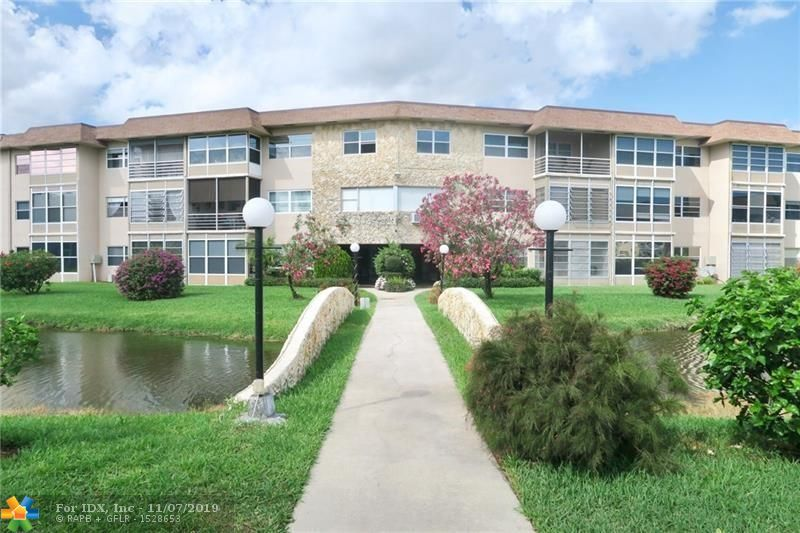 Charming First Floor Condo with awesome lake views. Conveniently located, this 1 bedroom condo is spacious and has an enclosed Florida room in the back. Well maintained. Walk In closet in Master! Hawaiian Gardens is a beautifully landscaped and popular 55+ community for snowbirds and local residents. Come see this one today!