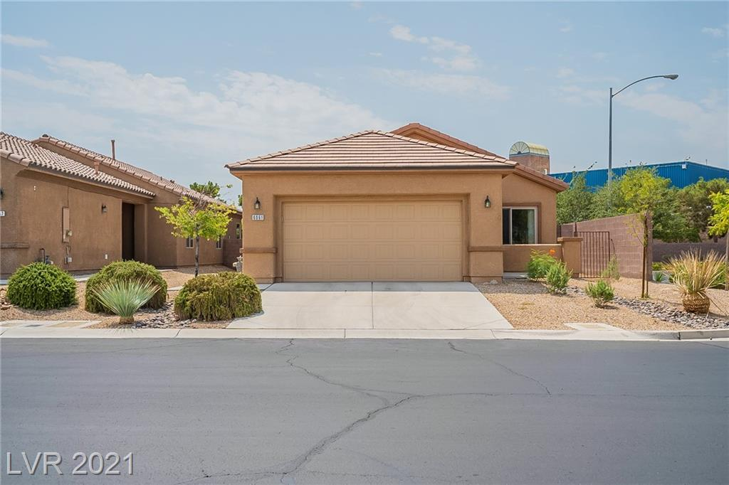 This Las Vegas one-story home offers a patio, granite countertops, and a two-car garage.