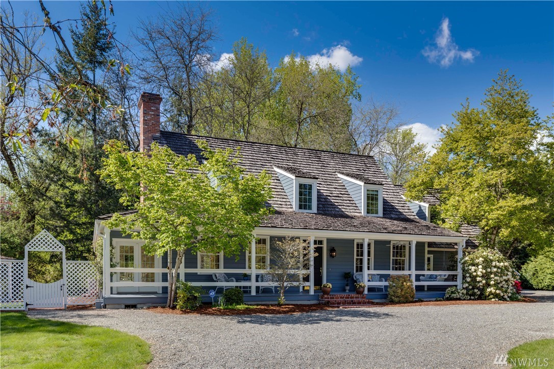 Live in the Homestead & this Williamsburg Colonial home on a beautiful salmon creek setting. Incredible street appeal with full length porch, bonus room, extra finished room, den, guest suite cottage w/ 2nd Kitch, ultimate artist studio along the banks of picturesque creek & fish ladder. Kitchen with cooking isle, new silestone counters, built in hutch, plank floors & beamed ceiling. Large gas fireplace, made to impress. Light filled Sunroom for am coffee. So much to see.. much more to enjoy!