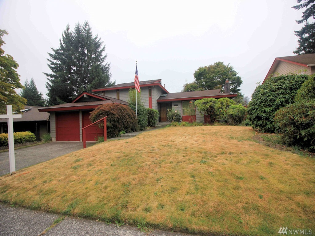 Solid house that just needs an update.  While updating add another bathroom in the unfinished laundry room downstairs (plumbing appears to be in place).  Two patios out back with mature landscaping and a Italian Prune tree. Great schools; Newcastle Elementary, Risdon Middle are within walking distance and Hazen a short bus ride away.  Minutes to Bellevue, Mercer Island and Renton.  Vibrant Newcastle shopping district is adding new stores and restaurants  regularly. Newer roof and exterior paint.