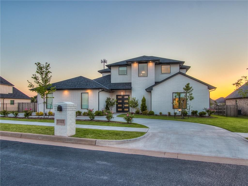 15113 Salem Creek Place is located within the gated community of The Lakes at Traditions on a nearly half-acre, premier lakefront lot. As you pull into the circle drive, this 5,400 square foot custom masterpiece will greet you with its modern flair & fresh contemporary styling. Once you step through the large double doors, you will be greeted by the awe-inspiring 14-foot entryway. Your senses will be overwhelmed by a tremendous amount of natural light, 12-foot ceilings throughout, open floor plan, & beautifully appointed kitchen w/ Frigidaire appliances coupled with a butler's pantry like you've never seen. Step just past the kitchen, through the large sliding glass door, and outside you will find a covered patio with equipped with an outdoor kitchen, refrigerator, dual fans, retractable shades, and a gorgeous heated pool. Pool equipped with complete pool automation via iAqualink. Home has five bedrooms w/ ensuites & walk-in closets (3 down & 2 up). Too much to list, schedule a tour.
