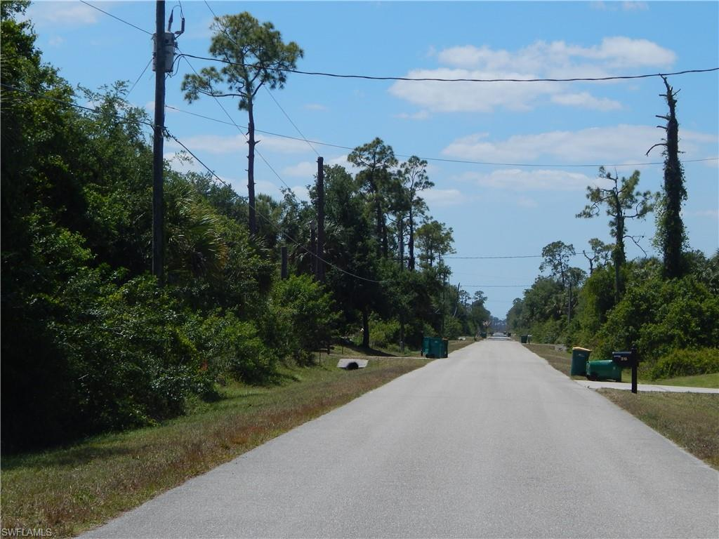 2.73 acres lot at Golden gate Estates. Build your dream home in a quiet but not far away area of Naples. Palm Trees, Live Oaks and many more trees.