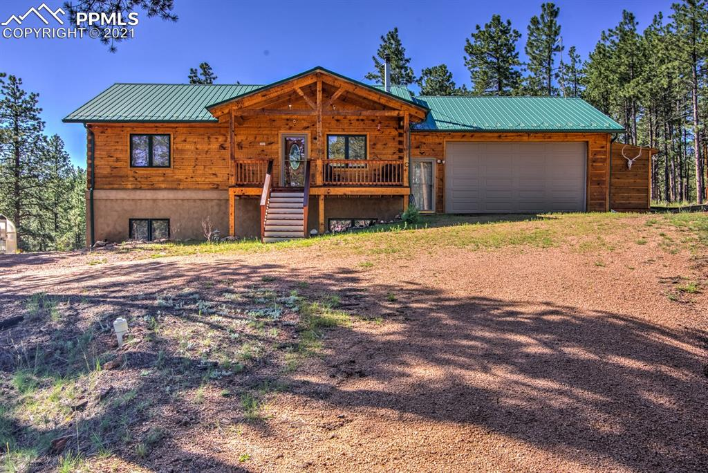 Fantastic dovetail-log home on 2 acres in Florissant. Home has been well taken care of and is in move in condition. Located just 25 minutes West of Woodland Park. Soaring vaulted ceilings on the main level living area, while the main log beam in the home came from the Mollie Kathleen Gold Mine in Cripple Creek!! There are numerous timber accents throughout the home giving the rustic flare. Oak Harwood flooring can be found in the entry, halls, dining and kitchen areas. Spacious kitchen has lots of countertop and cabinet