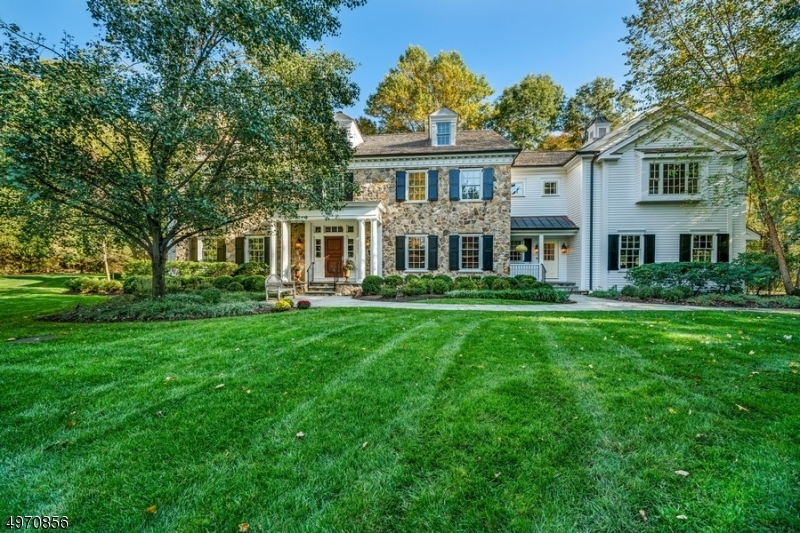 This exceptional 9500+ sq ft custom colonial offers a private oasis on 3+ acres in Harding, with low taxes. The gracious 2-story foyer leads to the 2-story great room with a wood burning fireplace. The adjacent gourmet kitchen has granite counters, high end appliances, an island and pantry. There is a wet bar near the formal DR, a mahogany office, sunroom, and formal LR. The back staircase near the mudroom goes upstairs and to the lower level full gym, sauna, custom mahogany bar, wine cellar with tasting room and entertainment area. The master suite has a FP, sitting room/office with a wet bar, a spa like master bath and 2 walk-in closets. There are 4 other bedrms, 3 other full baths and a laundry room on the 2nd level. The outdoor entertainment area is amazing. Finished 3rd floor, Full house generator.