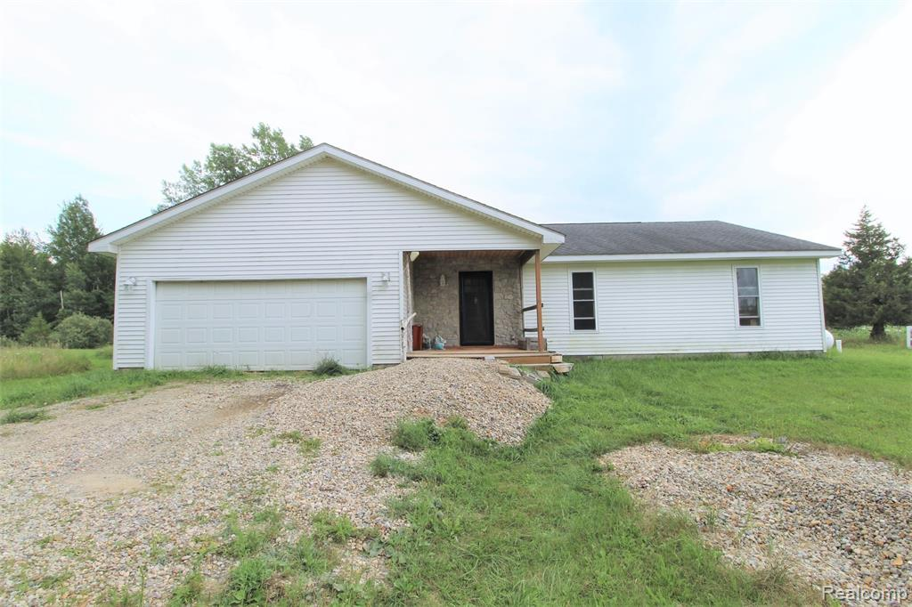 Built in 2005, this spacious open floor plan ranch home sits on 10+ acres and features a large kitchen, dining, and living area with a door wall leading to the private backyard. All three bedrooms are nice sized with the master bedroom including a walk in closest and attached master bath! Pella windows throughout the home. An additional bath with a walk in shower is located off the hallway. The crawl space has been professionally water proofed recently. Outside features a large 80'x20' pole barn with electricity and a metal roof. The home sits a few hundred feet off the road with lots of space from neighbors. The back portion of the property is wooded (about 20%) and deer are often seen. Only a short drive to Caro or M-46!