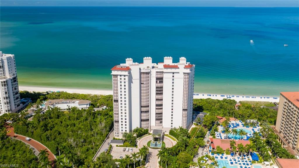 """C.18138 - Rare high floor 5-Star Beachfront Remington largest """"03"""" Tower JEWEL located on the perfect floor, touting an envious location, tucked smack-dab between The Naples Beachfront Ritz Carlton directly North and the Bay Colony Beach Club and Tennis Club directly South and East. It's overdue time to play, right? From the moment you step from your private elevator into this rare JEWEL, your soul recognizes you've come home. This Gem's beautifully appointed interior spaces and places artfully blend seamlessly with the generous outdoor westerly sunset Gulf front lanai offering mesmerizing, unobstructed, panoramic, tranquil, turquoise Gulf views where dolphins and manatees play, plus an equally generous easterly sunrise lanai, perfect for morning coffee. Dig your toes into Naples' sugar white sandy beach, just steps away from your Gulf front pool, encouraging long daily sunrise or sunset strolls, or a blissful Gulf dip. Don't forget to be pampered by the exceptional World Class Concierge services, along with the included lengthy menu of Bay Colony and Pelican Bay membership privileges."""