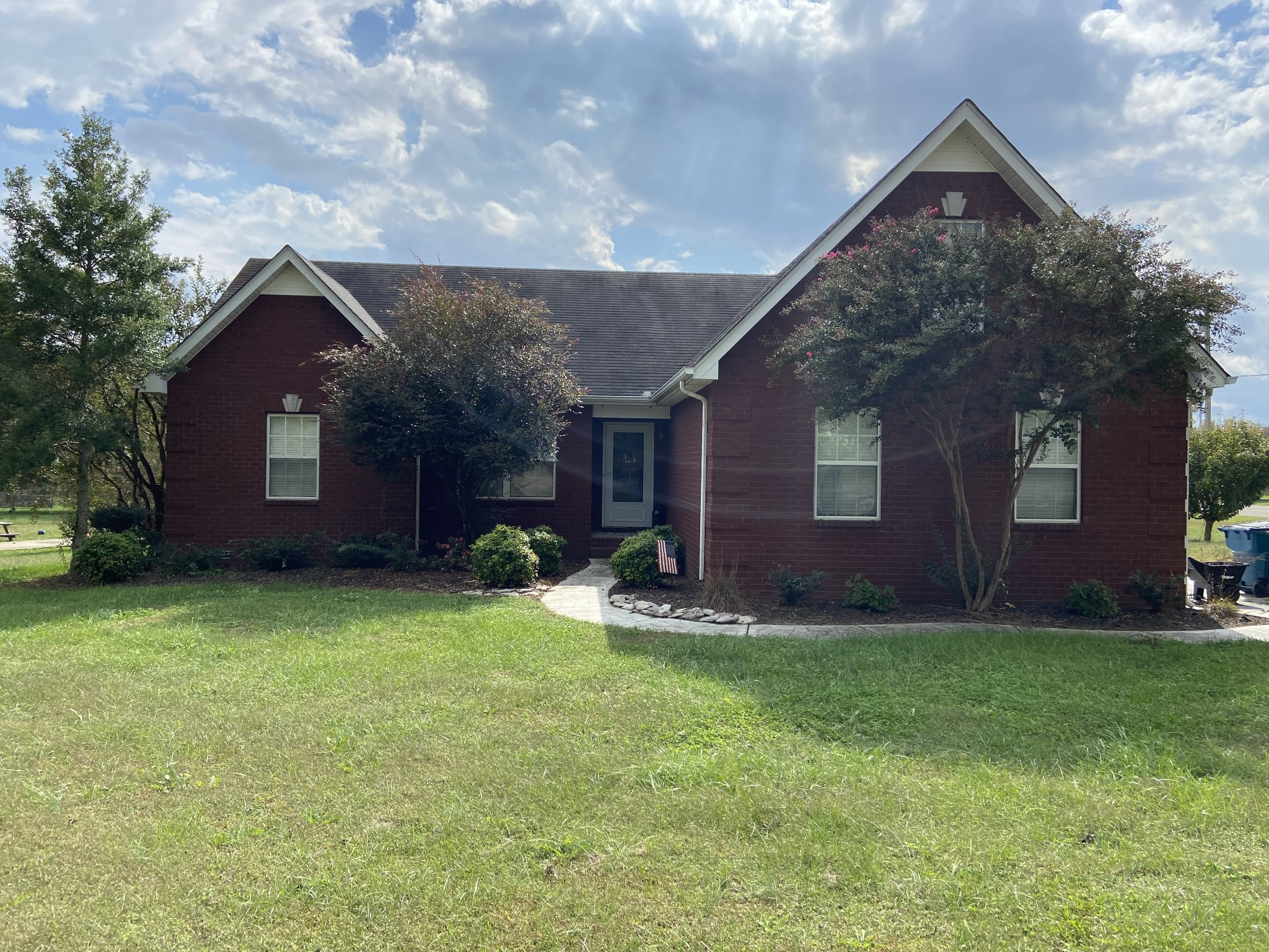 Welcome to Chapel Hills Subdivision. This home features: one level bedrooms & living area, tile floor in kitchen, bonus room over the garage, wainscoting in kitchen and dining room, a large yard on a corner lot Driveway with faux stones.