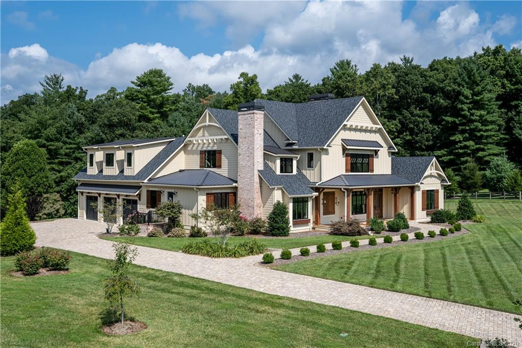 Winner of the North Carolina Home Builders Association Award for 2018 and the 2018 Asheville Parade of Homes Gold Craftsmanship Award. This open and light-filled farmhouse sits on 3 acres of level pastoral grounds in coveted Cane Creek Valley amongst other estate homes on a quiet cul-de-sac street. This beautiful home features a custom kitchen that comes with a complete Thermador package, leathered quartzite island, farmhouse sink, walnut and granite counters and an incredible butler's pantry. More custom details include handcrafted woodwork, stained beams and columns, plantation shutters, white oak floors and custom finishes throughout. All bedrooms are en suite with generous proportions. The home features a covered back porch and outdoor patio perfect for entertaining with a fireplace and grill as well as a three-car garage with epoxy flooring. Come see the quality for yourself.