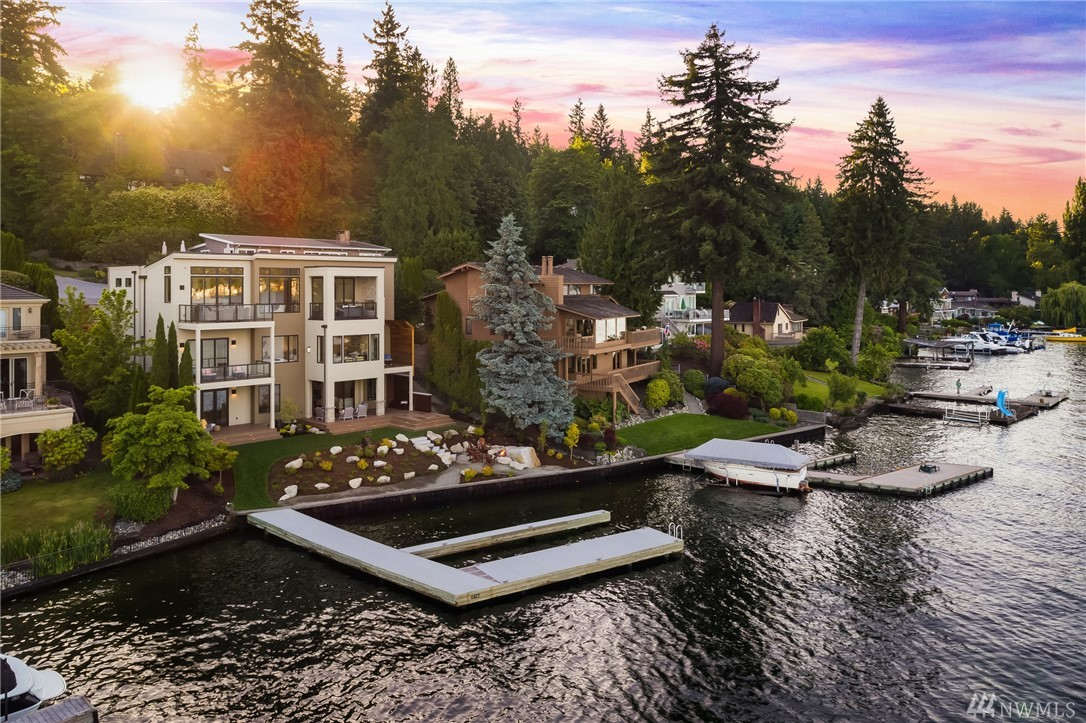 Stunning & bright NW Contemporary w/ Mt. Rainier views & 72 ft. of Lk WA waterfront. 6 above ground decks for entertaining. Chef's kitchen w/ Wolf/SubZero/Miele appl. & covered outdoor living rm w/FP. Upper master w/private deck & luxe en suite. Lower level bonus w/kitchenette unfolds to backyard w/outdoor shower, firepit, lush grounds & deepwater moorage. 2 full size laundry rooms. Premier waterfront living & quality construction. Stellar south-end location on bright lot. Award-winning schools.