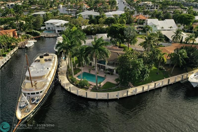 Rarely available sunrise key point lot with over 220 feet of water frontage and the ability to dock multiple mega yachts.  Brand new seawall and concrete dock. Amazing potential to renovate or build. Direct northeast views of middle river.