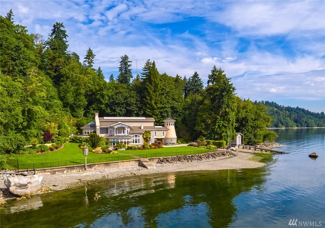 Magnificent Estate on Vashon Island. Enjoy privacy and quiet at your 24 acre and ~1000' waterfront estate. Spectacular views of Mt Rainier and the Puget Sound. This custom mansion will delight. The finest of details and craftsmanship throughout: Madrona hardwoods, statuary marble, and Chinese quartzite. Watch a movie in the theatre, practice putting on the green, taste wine in the wine cellar and take a dip in the hot tub. Garages for 6 cars. Boat house & ramp. Live. Enjoy. Make Memories Here.