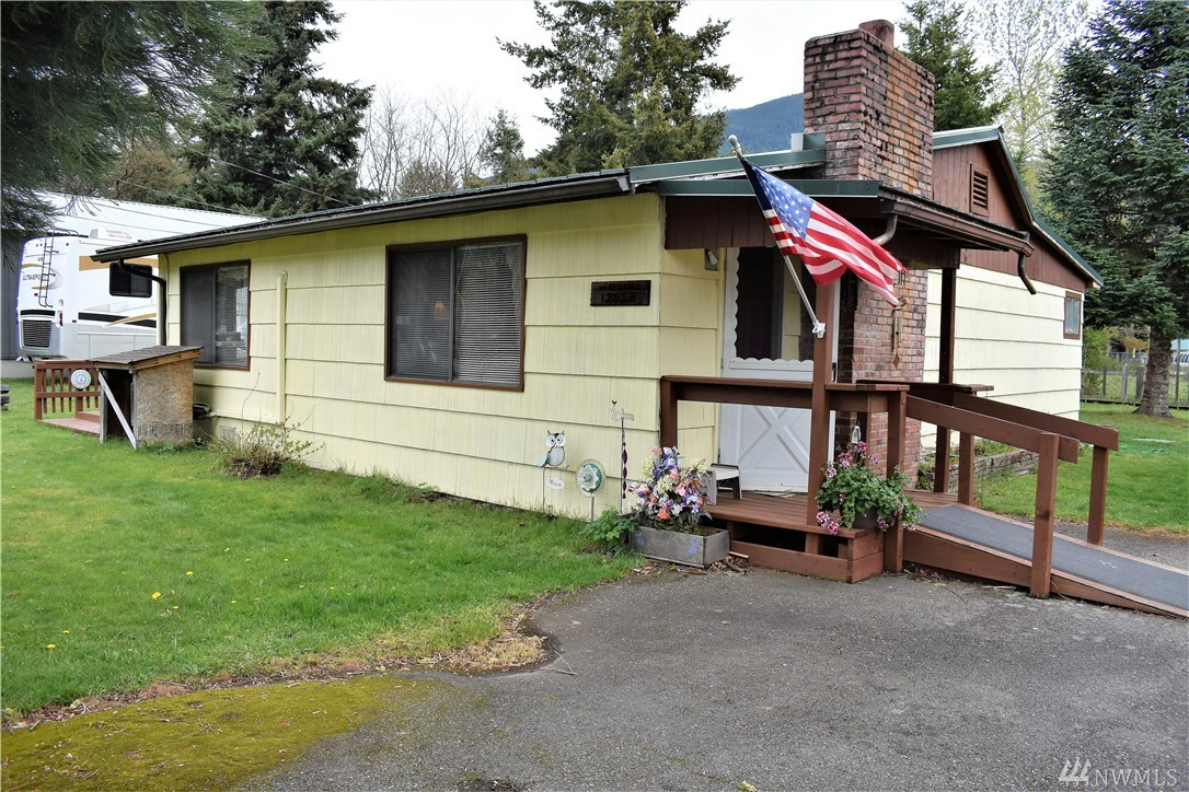 This investment opportunity offers flexibility! Adorable 2 bed 2 bath home is located in the heart of Packwood.  A short drive to White Pass Ski, Mt. Rainier, Pacific Crest Trail, and more. Detached garage and circle driveway. Nice sized backyard is partially fenced. Zoned STMU with highway 12 frontage. Large utility room with storage and craft space. Kitchen includes dining area with sliding glass door.  Generously sized master bedroom. Additional single wide manufactured is currently rented.