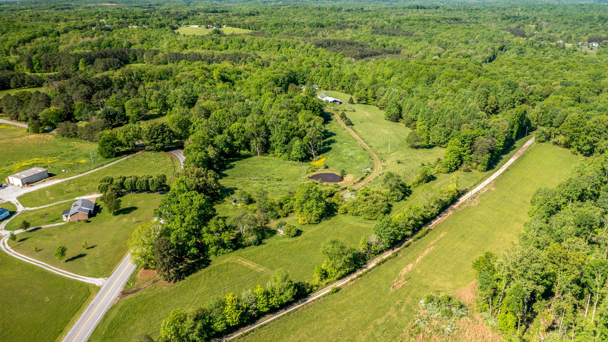Amazing piece of property/land in a wonderful area. Close to hw 96, I40 and I840. There are tons of possibilities with this unique property. You have a pasture and open fields along with beautiful mature trees. A pond, two springs and frontage on Turnbull creek. Power is already run to the back, and a well is in place. Two barns and some fences already in place. This is the Williamson county farm you have been searching for! **See the media section for drone video.