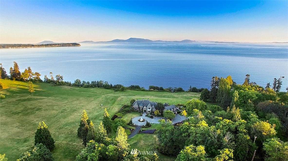 Gateway to the San Juans! Thoughtfully placed on 435'+/- waterfront with views over the San Juan's and the Canadian Gulf Islands. This gracious 11,966 sf, 5 bedroom main home on 15+ acres exudes luxury -- spectacular finish level with materials curated from around the globe, exacting standards, a focus on longevity. Stylish attached caretaker quarters, delightful gardens, and amazing beach. Easy access to international airport, world class marina, dining and more. Individually yours.