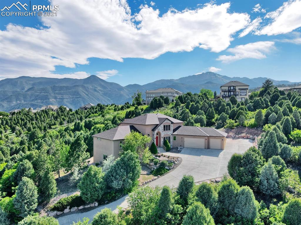 Don't miss this incredible property in the established Cedar Heights neighborhood with a HEATED DRIVEWAY and RV PARKING!! You will be amazed at the mountain and city views as you enter the vaulted ceiling great room complete with a stone fireplace. The open concept kitchen boasts granite countertops with eat in bar seating and formal dining room. The master bedroom has an en-suite 5 piece master bath and is conveniently located on the main level along with an office and laundry room. The hardwood floors throughout the main level have just been refinished and lead you to a fantastic trex deck with dual gas hookups and a built in hot tub! Upstairs you'll find an additional 3 bedrooms and full bath, all of which have unbelievable views! Don't forget about the enormous basement area with rec room, 2 additional bedrooms and full bath, ample storage, and a walk out! This RARE home in Cedar Heights stands out from the rest as it has great internet speed available, a fully fenced in dog run, brand new windows, brand new roof, new paint, walk in closets in all bedrooms, and much more! The security guarded entrance will give you peace of mind and you'll love the abundance of privacy this property provides! This home has been meticulously maintained and has a ton of upgrades/special features that you cannot find with any other property in the neighborhood! True Colorado living at its finest all the while being close to downtown Colorado Springs, Manitou Springs, Old Colorado City, hiking trails, shopping, schools and plenty of wildlife to enjoy in your very own backyard!