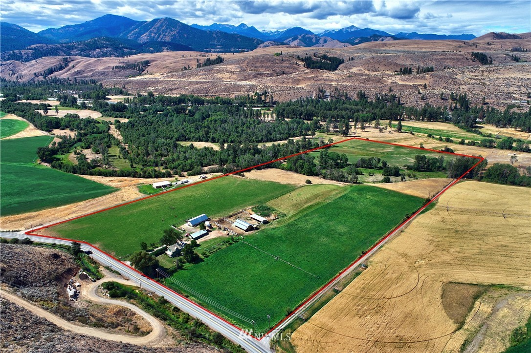 Historic Methow Farm, legendary producer, sprawling fields, farm structures, spell-binding views, and one heck of a place to live. 38.5 acres boiling with productivity, potential & serenity. Extensive irrigation, topography with intrigue & beauty. Authentic 1940 farmhouse, like taking a trip to Bridges of Madison County: perfect the old or build new. The glorious land and precious location are the prize here, protected by conservation easement. Former creamery facility, barns/utility buildings.