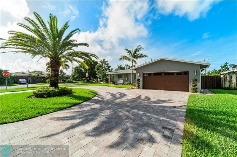 Large corner lot in Lighthouse Point. Hurricane impact windows & doors/hurricane impact garage door. Porcelain wood tile throughout the house. Large backyard with room for a pool. Roof is 6 years old. Home is turn-key and holds a very impressive feel inside and out.