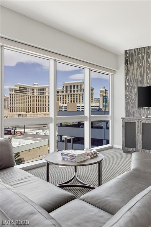 Rarely available corner unit located in The Martin. Take in Strip and mountain views straight from your residence. Huge wrap round terrace with beautiful highly upgraded carpet. Open kitchen features stainless steel appliances and a custom backsplash. Other Features include: Designer furniture, marble bathrooms, electric blinds, resort-style amenities and more!