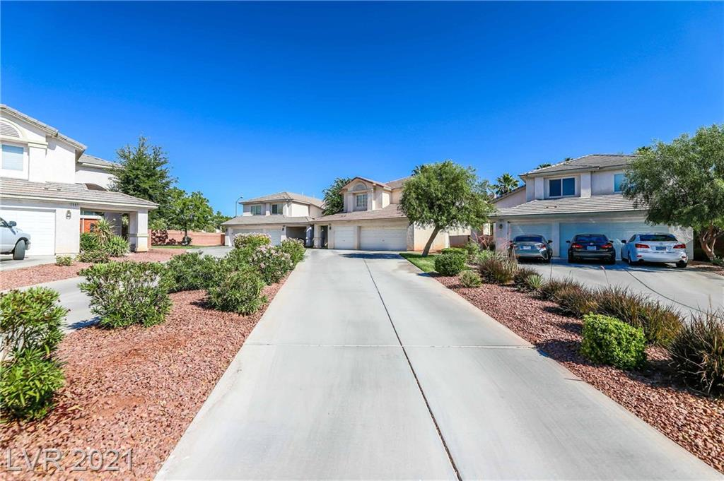 Gorgeous, centrally located 4 bedroom 3 bathroom home in gated community.  Beautiful hardwood floors and remodeled kitchen are just a few of the features that make this home extremely desirable.  With easy access to the strip this home won't last long.  Schedule a viewing today!!