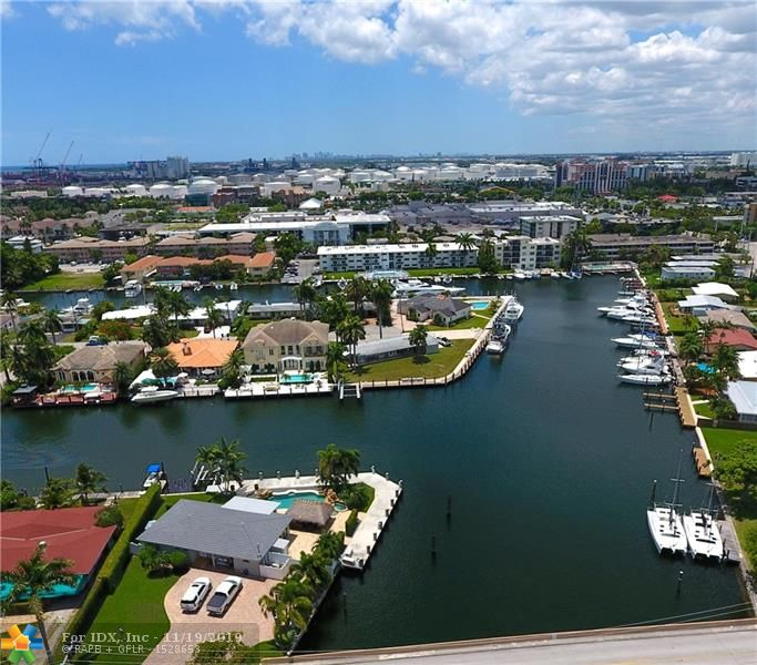 WOW! 207' of Deep Waterfront dockage! 100' plus Yacht? Bring it! This is a Fabulous Point Lot w/ Largest Turning Basin in Fort Lauderdale.  Lots of Dockage for you and your friends big boats too!. This type of waterfront dockage is hard to find at a private residence. Only a few minutes to Port Everglades. Oh, and the home? A beautiful 4 Bed / 3.5 Bath w/Split Bedroom Plan.  Amazing Modern Kitchen, Sparkling Floors throughout. Panoramic Water Views, NEW ROOF!  Plenty of dockage for a fleet of boats as well as a 4 post boat lift. Enjoy yourself with a dip in the Tropical Freeform Pool and Hot Tub after a nice cruise on your boat. Expansive Patios w/Travertine Pavers surrounded by lush landscaping and grassy play areas enhance your fun lifestyle in this Piece of Paradise.