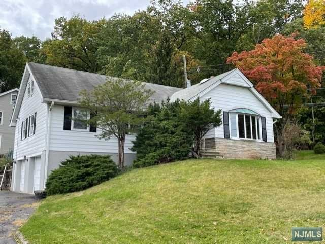"""Sizeable Home near Upper Montclair. Needs TLC. Chance to add your finishing touches to create your ideal home. Main level offers open Living Rm and Dining Rm perfect for entertaining; Large Eat-In-Kitchen with dining area; MstrBdrm with Private FullBA; 2nd Full Size Bdrm and Main FullBA; Den/Office; convenient Laundry Rm and Bonus Florida Rm. 2nd Level offers 2 more large Bdrms and 3rd FullBA. Full Bsmt can be finished. Gleaming hardwood floors. NY Bus at corner of Valley. Near Downtown Montclair and MSU. Sold strictly """"as is"""" with Great potential."""